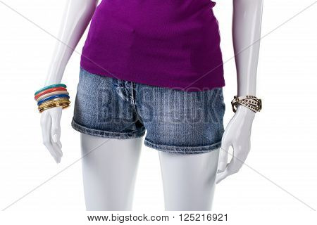 Purple top and denim shorts. Mannequin wearing blue denim shorts. Garment of high-quality denim. Short denim shorts on display.