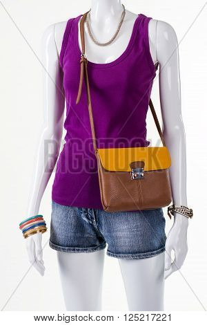 Purple tank top and accessories. Female mannequin wearing summer outfit. Lady's light outfit with handbag. Young lady's stylish summer look.