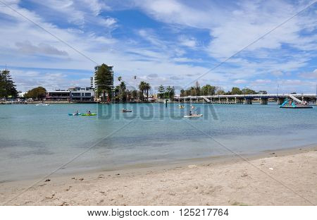 MANDURAH,WA,AUSTRALIA-MARCH 7,2014: People kayaking in the Peel-Harvey Estuary under a blue sky with clouds in Mandurah, Western Australia.
