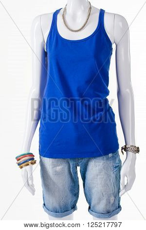 Shorts with top and bijouterie. Mannequin in female summer outfit. Light apparel for warm season. Follow the trend.