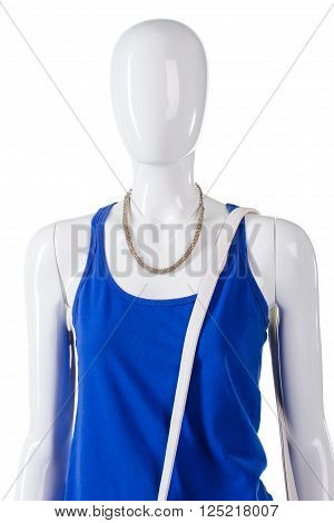 Blue top and white strap. Leather strap over mannequin's shoulder. Woman's simple high-quality clothing. Spare white strap for bag.