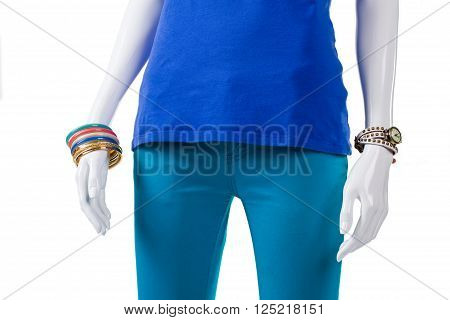 Colorful bijouterie with turquoise pants. Female mannequin wearing turquoise garment. Lady's high-quality trousers. Brand new clothing at boutique.