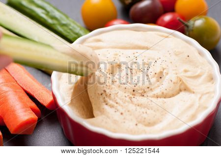 ground chickpea hummus with flatbreads and vegetables for dipping