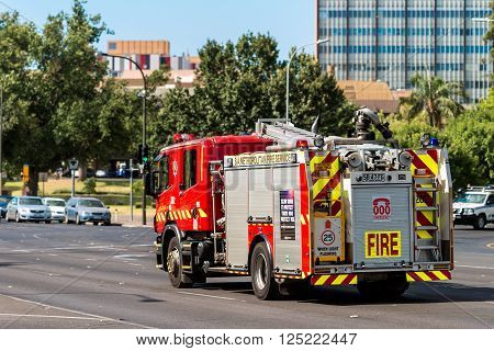 Adelaide Australia - January 3 2016: SA Metropolitan Fire Service Truck driving to an incident along King William road in Adelaide