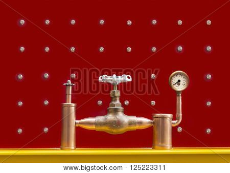 System with a valve pressure manometer and safety valve on a red background with screws