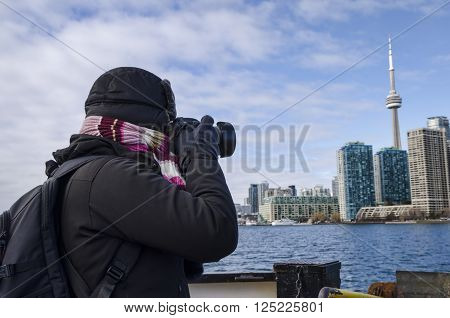 Toronto, Canada - January 27, 2016: Person Taking Photos Of Toronto Skyline From A Ship, Ontario, Ca