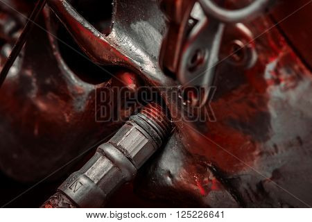 Abstract steel bacgkround closeup photo with red glass