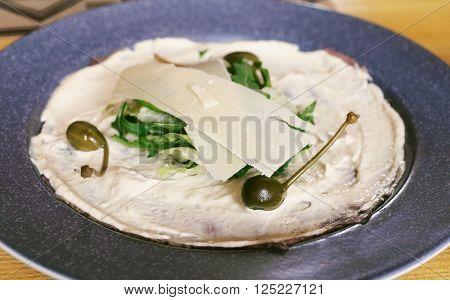 Italian dish Vitello Tonnato pieces of marinated beef, seasoned tuna cream sauce