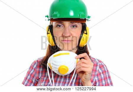 Female construction worker with protective mask wearing green helmet and protective headphones, safety at work and ear protection. White background