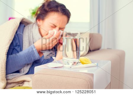 Sick Woman Sneezing into Tissue. Allergy reaction. Flu.Woman Caught Cold. Headache. Virus. Flue