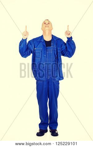Repairman pointing up with both hands