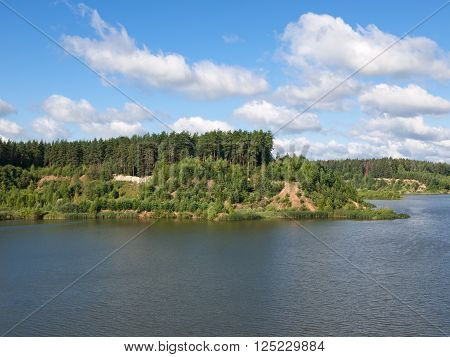 The hilly peninsula on the lake on a sunny day