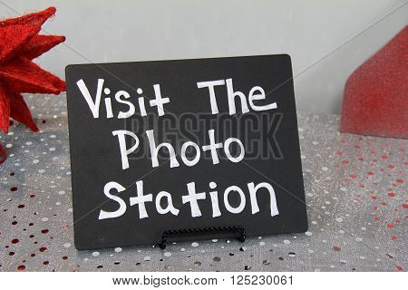 Cute little chalkboard sign that invites guests to visit the photo station to get their picture taken during the celebration.
