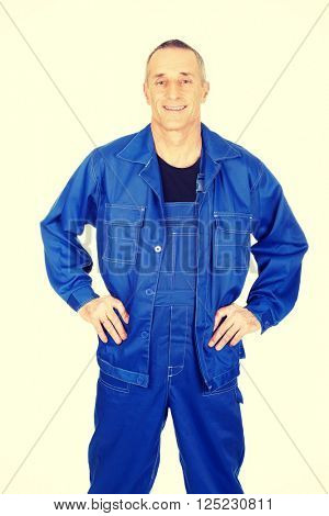 Smiling repairman with hands on hips