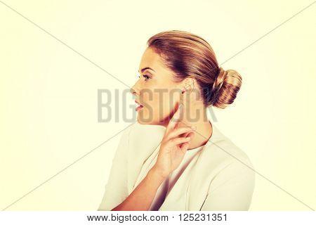 Beautiful businesswoman overhears a conversation