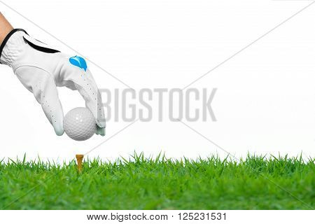 Hand hold golf ball with tee isolated on white background