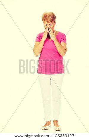 Senior woman with huge sinusache