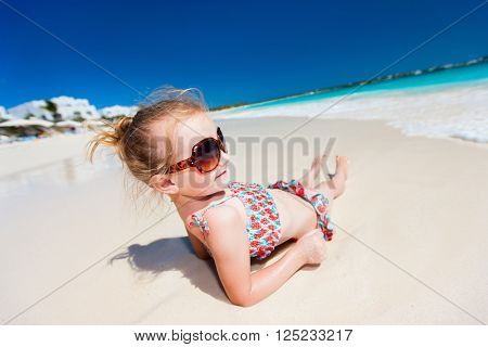 Wide angle view of adorable little girl at tropical beach
