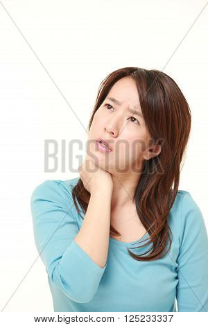 portrait of Japanese woman suffers from neck ache