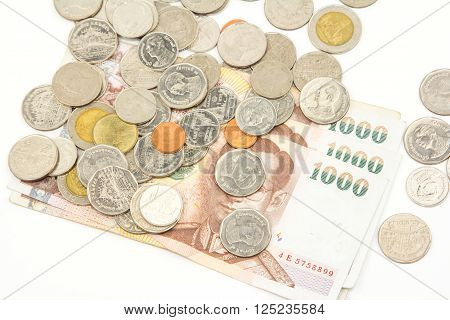 Bank Notes and Coins in Thai Baht Currency on white background.