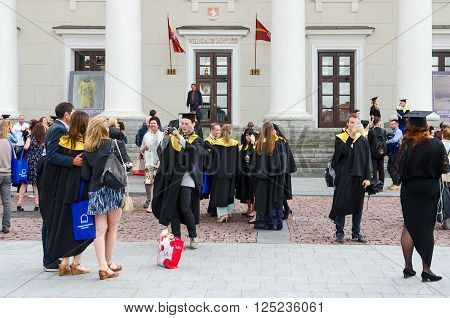 VILNIUS LITHUANIA - JULY 10 2015: Graduates of the European Humanities University after the official graduation ceremony near the Town Hall Vilnius Lithuania