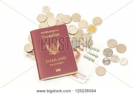 Thailand passport and Thai baht coin money on white background.