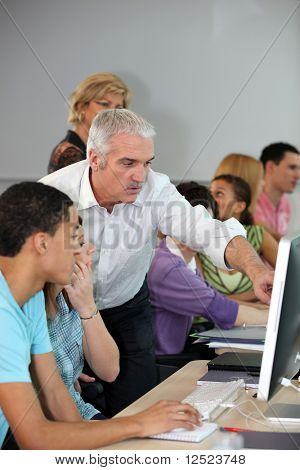 Teacher in class with students