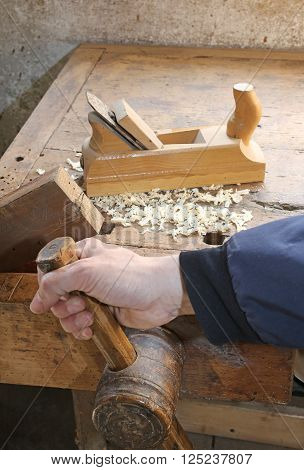 hand of the young carpenter tightens its grip in woodworking
