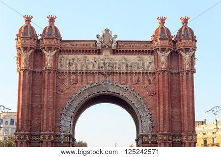 Barcelona, Spain - November 11, 2015: Triumphal arch Arc de Triomf. The arch was built as the main access gate for the 1888 Barcelona World Fair by architect Josep Vilaseca i Casanovas.