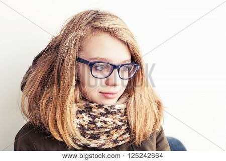 Caucasian Teenage Girl In Glasses And Warm Scarf