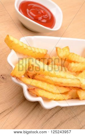 Close up of French fries in a white bowl