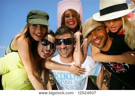 Group of friends having fun in summer