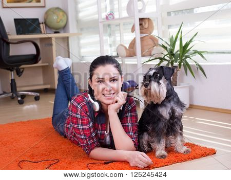 Girl And Dog On The Carpet
