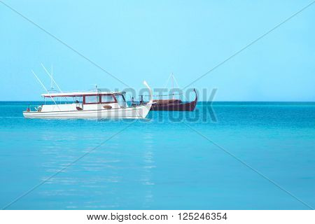 Boats in blue ocean. Summer vacation concept.