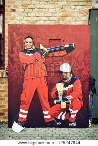 Photo cutout board. Funny people taking pictures in rescue clothes. Humorous scene.