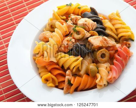 Italian fusilli pasta with chicken bytes and green olives