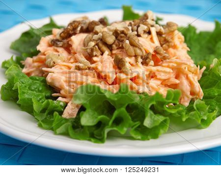 Coleslaw salad with walnuts over fres lettuce. Horizontal shot