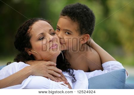 Little boy giving a kiss to his mom