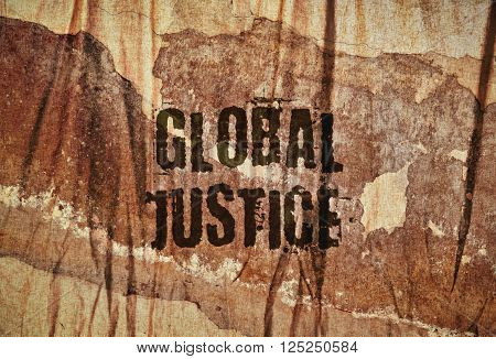 Text Global Justice written on rough textured brown background
