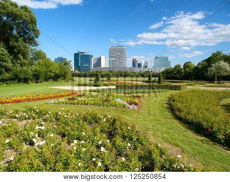 Office buildings in Danube City, Vienna, Austria. Beautiful garden and tree in foreground