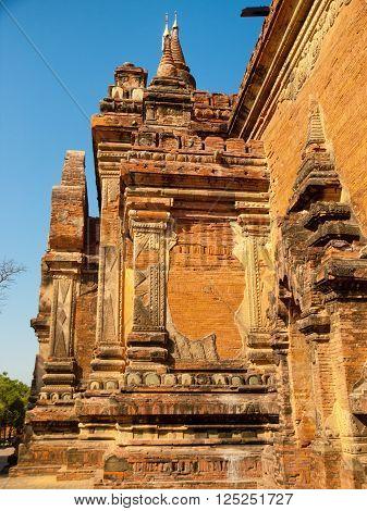 Outdoors view of Htilominlo Temple in Bagan, Myanmar. Vertical shot