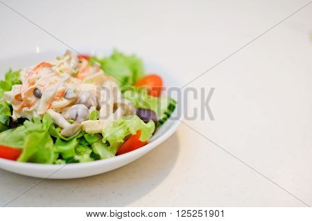 Fresh mixed salad , salad leaves and other vegetables, on the table