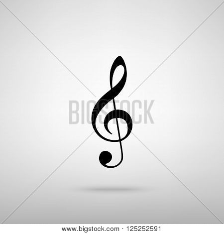Music violin clef sign. G-clef. Treble clef. Black with shadow on gray.