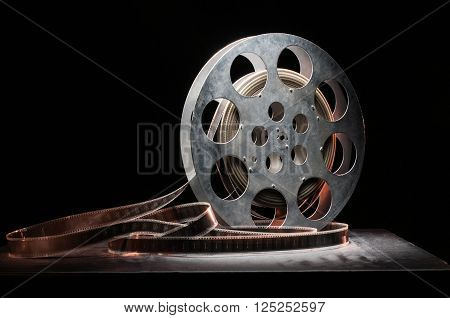 Movie old reel on a wooden background