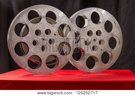 Movie reel on a red table fnd black background