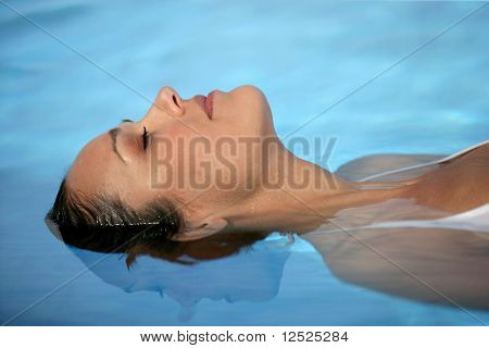 Portrait of woman floating in swimming pool