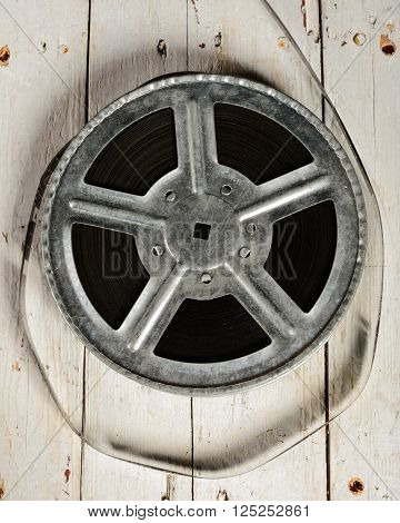 Movie reel on a white wooden background