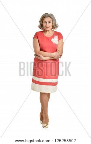 Portrait of senior woman in bright dress on white background