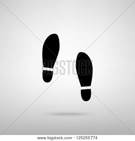 Imprint soles shoes sign. Black with shadow on gray.