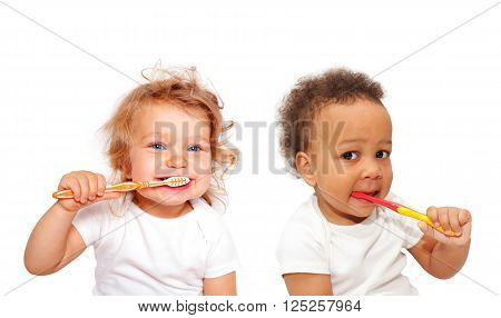 Black and white baby toddlers brushing teeth. Isolated on white background.